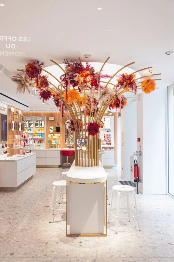 nicolle white stool in a Clarins shop